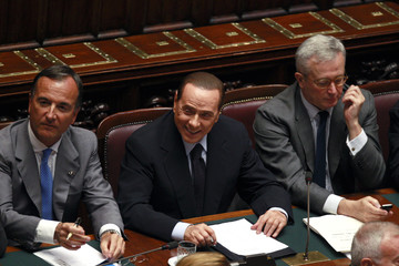 Italy's PM Berlusconi, Foreign Minister Frattini and Finance Minister Tremonti attend a debate in upper house of parliament in Rome