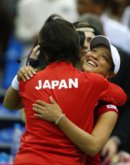Japan's Morita celebrates with captain Murakami her victory over Russia's Vesnina in their Fed Cup first round tennis match in Moscow