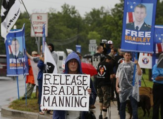 Protesters call for the release of U.S. Army PFC Manning outside the main gate of U.S. Army Ft. Meade in Maryland
