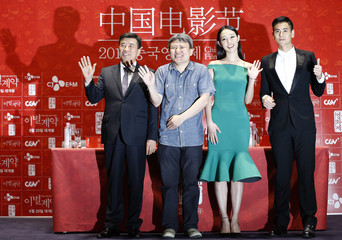"""CEO of CJ E&M Kang, Director Oh, cast members Bai and Peng pose for photographers during news conference to promote their movie """"A Wedding Invitation"""", the closing film of the Chinese Film Festival, in Seoul"""