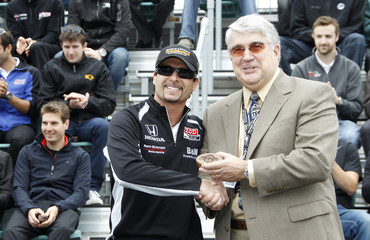 Ken Keltner of HerffJones presents his starter ring to pole sitter Alex Tagliani of Canada in Indianapolis
