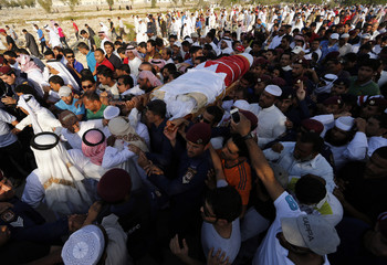 Mourners, including family members, carry the body of policeman Ammar Abdulrahman Ali during a funeral procession in Hananya