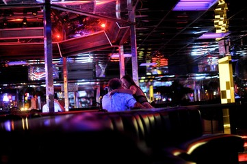 A strip dancer mingles with a customer at the Mons Venus strip club in Tampa
