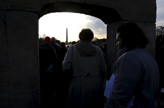 "Participants in a Easter Sunday sunrise Christian religious service pass through a ""Resurrection Gate"" temporarily installed at the Lincoln Memorial in Washington"