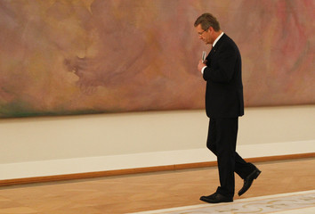German President Wulff leaves after making a statement in the presidential Bellevue palace in Berlin