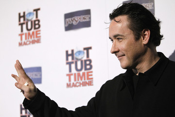 "Cusack waves at the premiere of ""Hot Tub Time Machine"" in Hollywood"