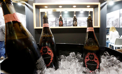 Bottles of Berlucchi's rose' sparkling wine from Franciacorta area are seen at the 50th Vinitaly international wine and spirits exhibition in Verona