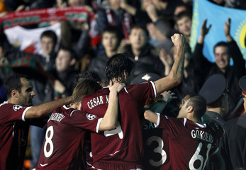 Rubin Kazan's team players celebrate their goal against Barcelona during their Champions League Group D soccer match at Central stadium in Kazan