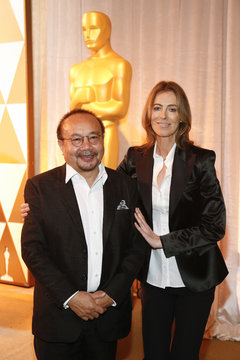 Director Panh accepts his nomination certificate from presenter director Bigelow, at the 86th Academy Awards Foreign Language Nominee Reception at Ray's and Stark Bar on the LACMA Campus in Los Angeles