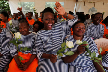 """Female inmates cheer after receiving rose flowers intended for Valentine's Day, during a celebration dubbed """"love behind bars"""" inside the Langata Women Maximum Security Prison in Kenya's capital Nairobi"""