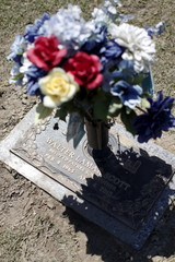 A bouquet of flowers marks the grave before relatives and friends gathered to remember Walter Scott, at Live Oak Memorial Gardens in Charleston
