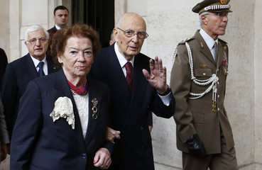 Italian President Napolitano waves next his wife Clio as he leave the Quirinale presidential palace in Rome