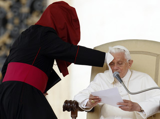 A gust of wind blows Pope Benedict XVI's mantle during his weekly general audience at St. Peter's Square in the Vatican