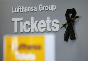 The logo of Germanwings, a member of the Lufthansa Group, is seen next to a black ribbon and a flower commemorating the victims of Germanwings flight 4U9525, in Duesseldorf airport