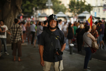 A fireman poses for a photograph as he takes part in a protest march against austerity measures in Malaga