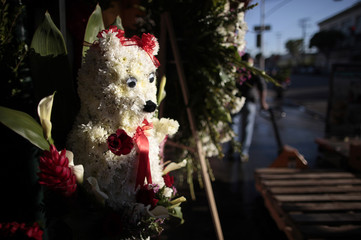 A teddy bear made from flowers sits in outside a florist store in preparation for Valentine's Day in Los Angeles