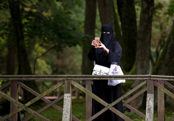 Tourist takes pictures at Vrelo Bosne nature park in Ilidza near Sarajevo