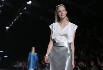 A model presents a creation by Japanese designer Yoshiyuki Miyamae as part of his Spring/Summer 2014 women's ready-to-wear fashion show for house Issey Miyake in Paris