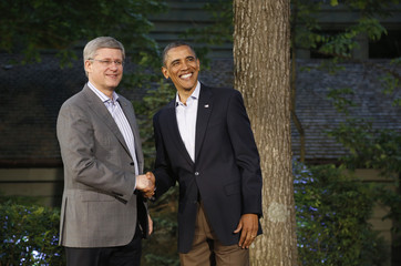 U.S. President Obama greets Canada's Prime Minister Harper as he arrives at the G8 Summit at Camp David