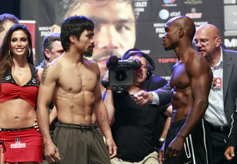 Filipino boxer Pacquiao prepares to pose with U.S. boxer Bradley Jr. during an official weigh-in at the MGM Grand Garden Arena in Las Vegas