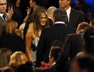 Jennifer Aniston chats during a break in the show during the 21st Annual Critics' Choice Awards in Santa Monica