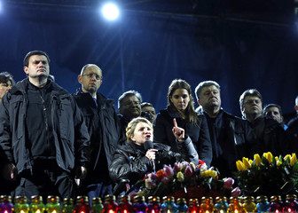 Ukrainian opposition leader Tymoshenko addresses anti-government protesters gathered in the Independence Square as her daughter Yevgenia and opposition leader Yatsenyuk look on in Kiev