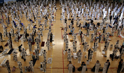 Participants show off their writing at a New Year calligraphy contest in Tokyo