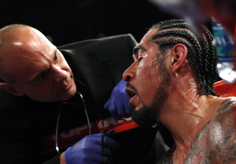 Margarito from Mexico is inspected by the ring doctor during his fight against Cotto of Puerto Rico in their WBA World Junior Middleweight championship boxing match in New York