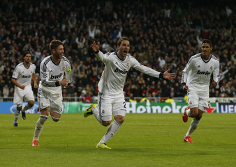 Real Madrid's Gonzalo Higuain celebrates his goal against Galatasaray during their Champions League quarter-final, first leg soccer match in Madrid