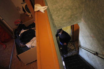 Boxes containing clothes sit on the floor as Carlos Roberto Quinones waits to be evicted after failing to pay the mortgage in Madrid
