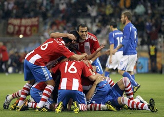 Paraguay's players celebrate Antolin Alcaraz's goal against Italy during their 2010 World Cup Group F soccer match at Green Point stadium in Cape Town