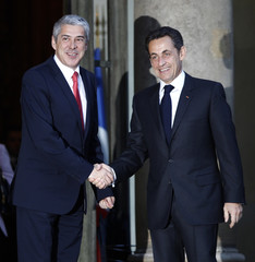 France's President Sarkozy shakes hands with Portuguese Prime Minister Socrates as he arrives at the Elysee Palace in Paris