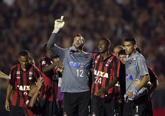 Goalkeeper Weverton of Brazil's Atletico Paranaense celebrates beating Peru's Sporting Cristal during their Copa Libertadores soccer match in Curitiba