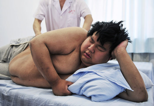 A patient receives a massage at a weight loss centre in Changchun