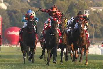 """Jockey Hernan Eduardo Ulloa on """"Rio Allipen"""" crosses the finish line to win the 131st running of the Derby horse race at Sporting Club in Vina del Mar city, Chile."""