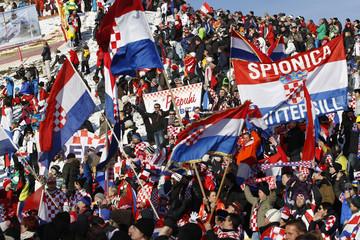 Spectators wave Croatian national flags during men's slalom race at Alpine Skiing World Cup in Kitzbuehel