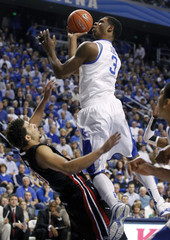University of Kentucky's Terrence Jones fights for a shot under pressure from University of South Carolina's Anthony Gill in Lexington