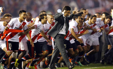 Gallardo, coach of Argentina's River Plate, and his players react after winning their Copa Sudamericana finals soccer match against Atletico Nacional of Colombia, in Buenos Aires