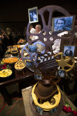 Master chef Puck is seen through chocolate sculpture as he speaks to media during preview of food and decor for 87th Academy Awards' Governors Ball at the Ray Dolby ballroom in Hollywood
