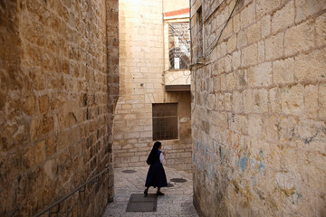 A nun walks in an alley in the Christian Quarter of Jerusalem's Old City