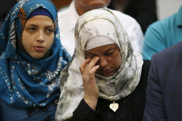 Mother of Palestinian teenager Abu Khudair, who was killed in Jerusalem in 2014, reacts after a ruling against one of her son's murderers, Ben-David, at Jerusalem's District Court