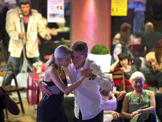 A couple dances during a Saturday milonga session, animated by DJ Paul of Montpellier, at the TNT Lyon Tango club in Lyon