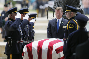 Dallas Police Honor Guards salute during an Honor Guard Ceremony for Dallas Police Department in Plano