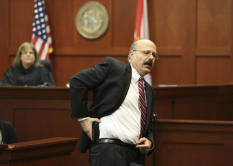 Assistant state attorney de la Rionda demonstrates to the jury how George Zimmerman allegedly pulled his gun during closing arguments in Seminole circuit court in Sanford