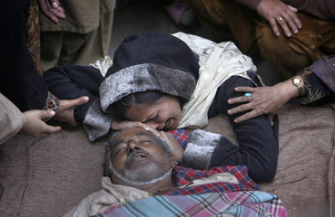 Lubna mourns over the body of her uncle Chaudhry Mohammad Gulab, a heart patient, who died in Lahore