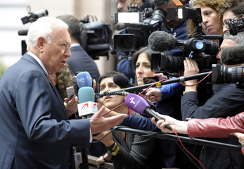 Spain's Foreign Minister Garcia-Margallo Y Marfil speaks to members of the media during a meeting of European Union (EU) foreign ministers at the EU Council in Brussels