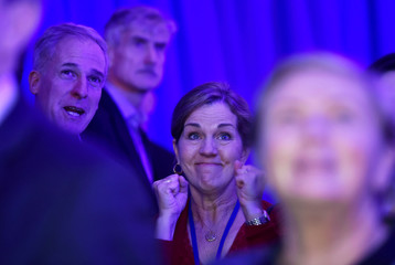 People react to the television coverage of U.S. presidential election results during an election party at the U.S. embassy in London