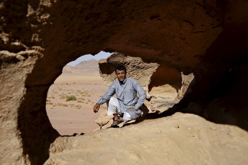 "Hussein Suweilheen, one of the cast members of Jordanian movie ""Theeb"" (Wolf), poses for a photo in Wadi Rum, Jordan"