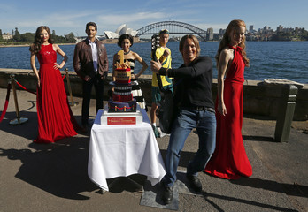 Wax figures of Australian celebrities Kerr, Bana, Minogue, Hewitt, Urban and Kidman are placed for pictures in front of the Sydney Opera House and harbour bridge