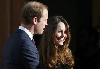 Britain's Prince William and Catherine, Duchess of Cambridge, leave after a visit to the Only Connect head office in central London